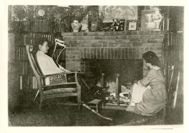 """[Music Library] Mrs. Edward MacDowell in her home, """"Hillcrest"""" at Peterborough, New Hampshire. The young girl in the picture is May Wills, a pupil of Edward MacDowell. Miss Wills married Frederick Ballard, a playwright, the author of """"Believe Me Xantippe,"""" acted by John Barrymore and """"Trial by Jury,"""" by Minnie Maddern Fiske. [photograph left by Miss Fiske]"""