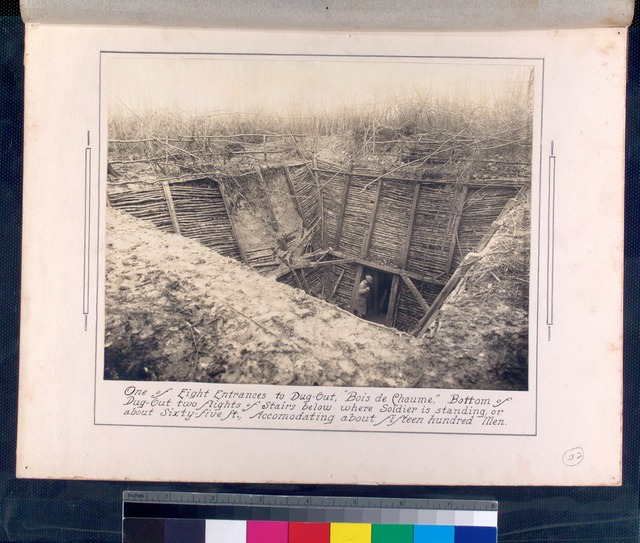 One of eight entrances to dugout, Bois de Chaume, bottom of dugout two flights of stairs below where soldier is standing, or about sixty-five ft., accomodating about fifteen hundred men.