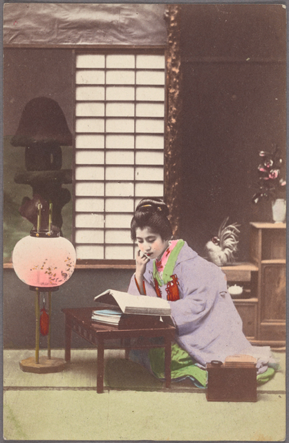Young woman reading near lamp.