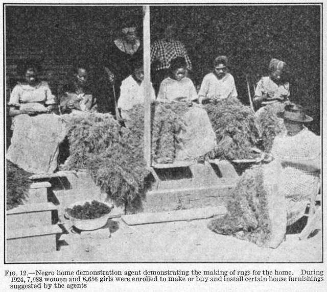 Negro home demonstration agent demonstrating the making of rugs for the home; During 1924, 7,688 women and 8,656 girls were enrolled to make or buy and install certain house furnishings suggested by the agents.
