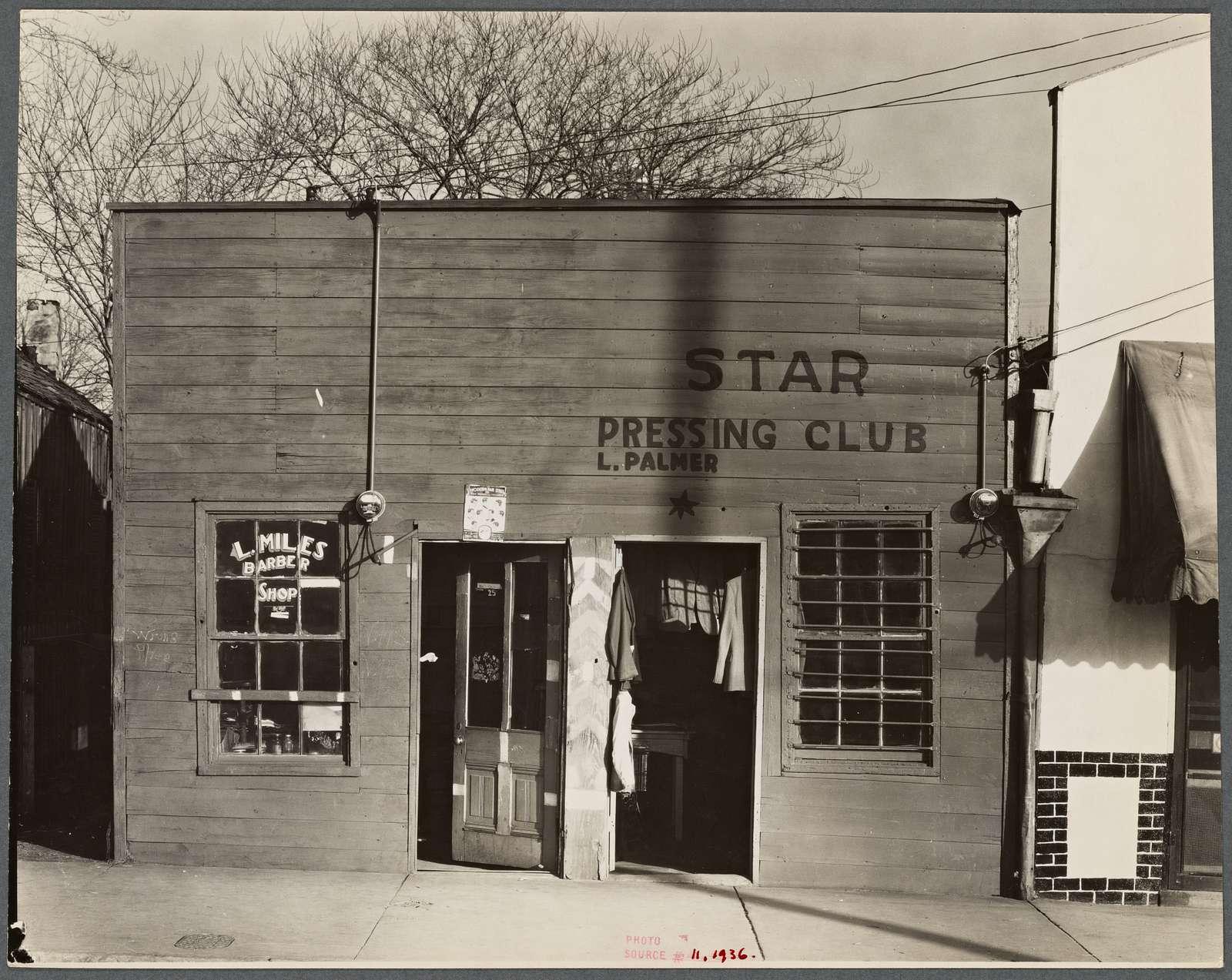 Shop fronts, laundry and barber shop. Vicksburg, Mississippi. Negro shop