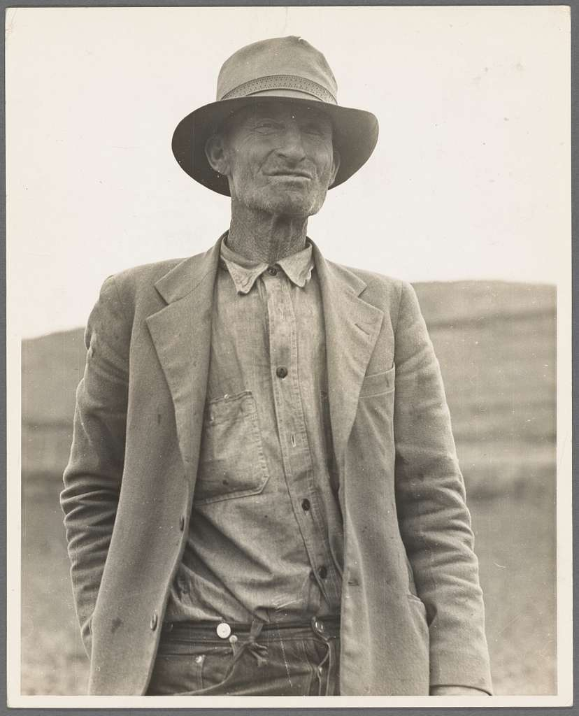 """This man is a labor contractor in the pea fields of California. """"One-Eye"""" Charlie gives his views. """"I'm making my living off of these people (migrant laborers) so I know the conditions."""" San Luis Obispo County, California"""