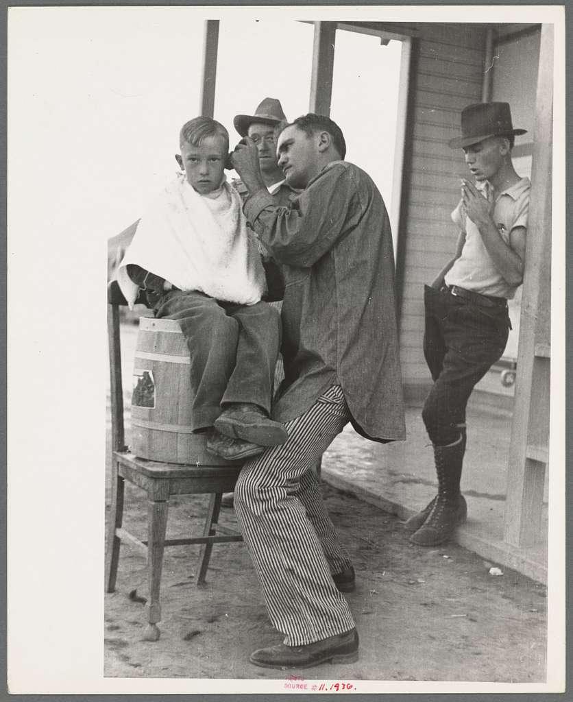 Community barber shop in Kern County migrant camp, California