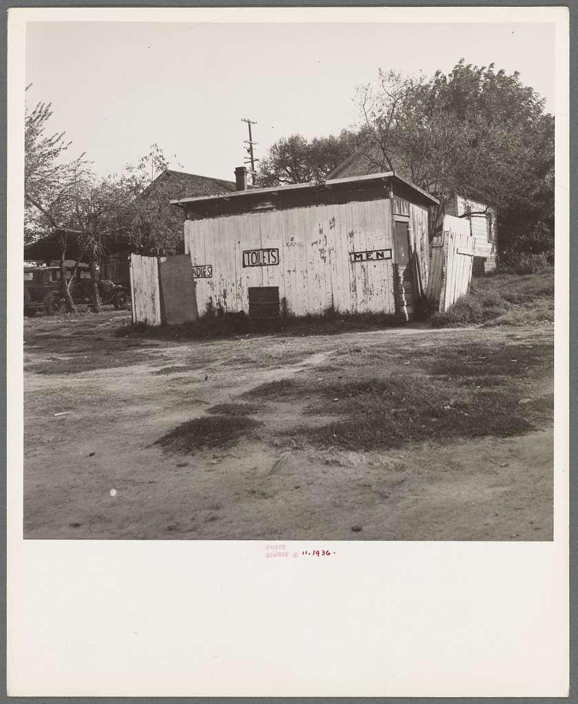 Privy in cheap migratory camp. San Joaquin Valley, California