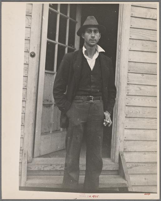 Man with cigarette in doorway.