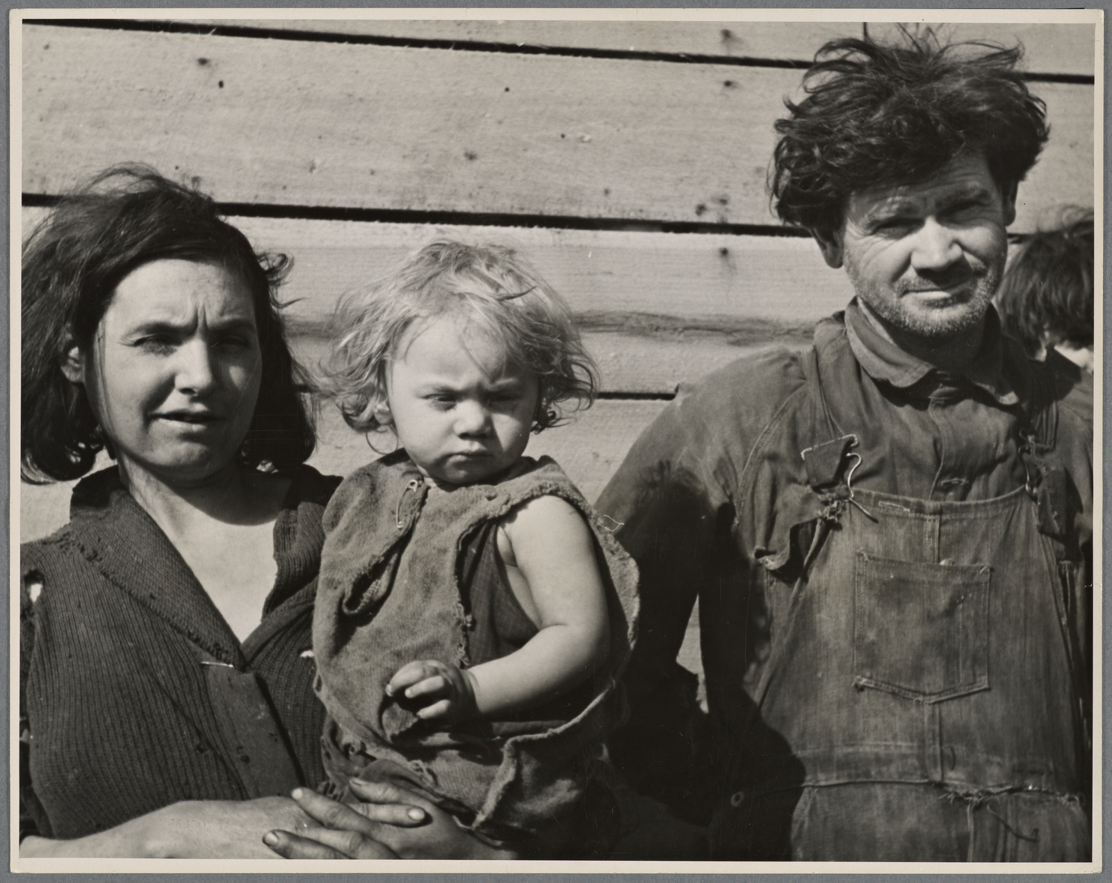 Mother and father and several children of a family of nine living in open field in rough board covering built on old Ford chassis on U.S. Route 70, between Bruceton and Camden, Tennessee. Their water supply was an open creek running near highway.