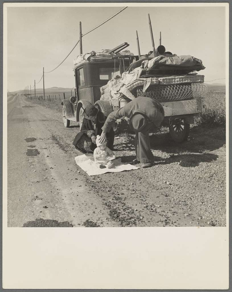 Missouri family of five, seven months from the drought area, on U.S. Highway 99 near Tracy, California