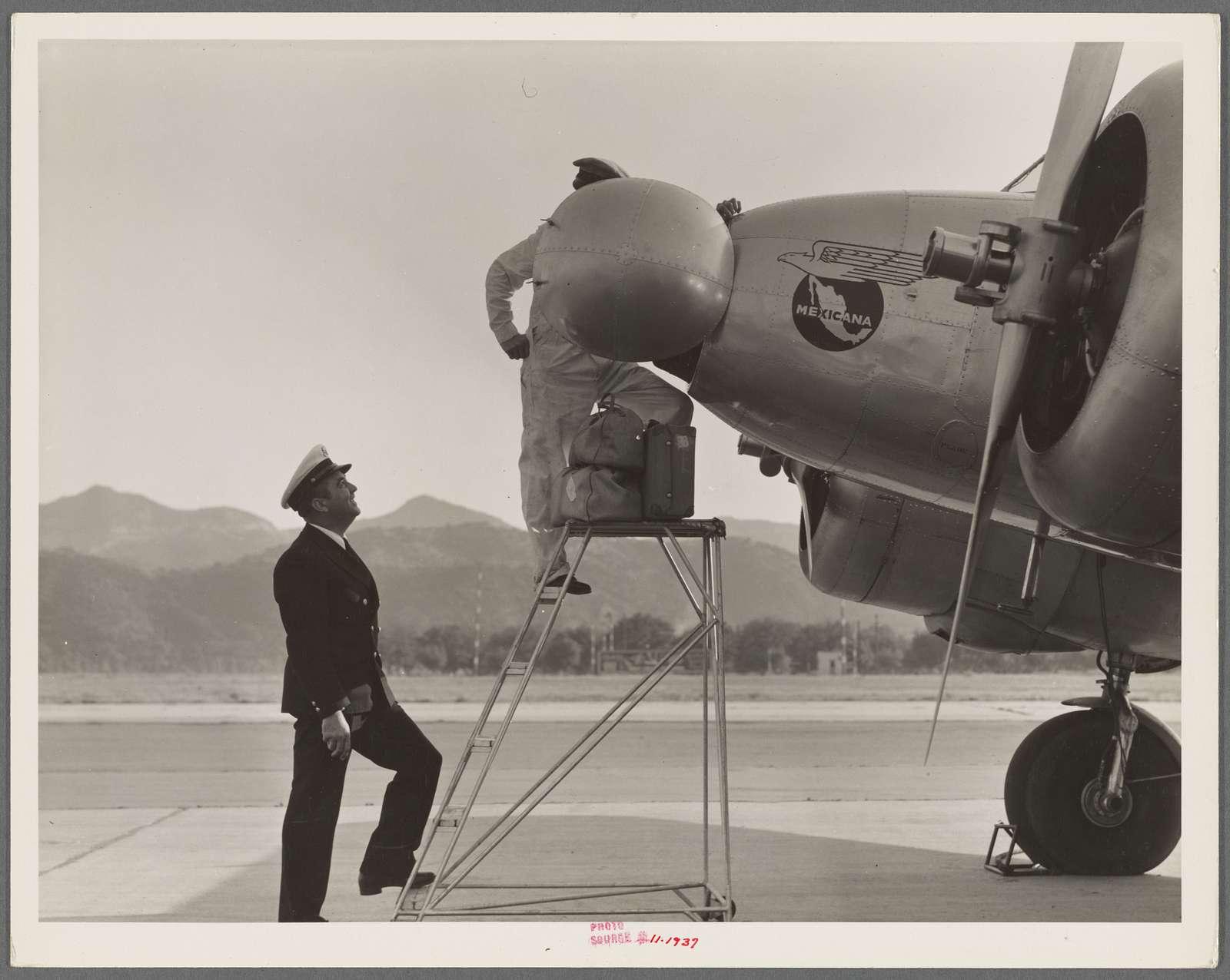 Plant quarantine inspectors examining plane at the Glendale Airport, California