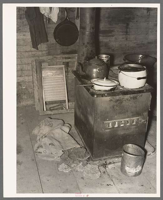 Kitchen stove and bag full of cow dung used as fuel, Sheridan County, Montana