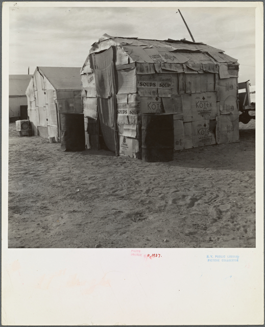 Migratory field worker's home on the edge of a pea field. The family lived here through the winter. Imperial Valley, California