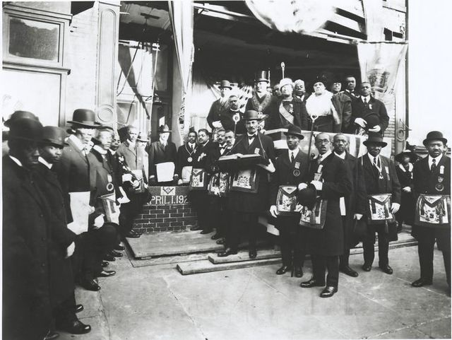 Schomburg among Masons and Odd Fellows at the cornerstone laying of the Ionic Temple, 165 or 167 Claremont Avenue, Brooklyn, N.Y., April 1, 1922.