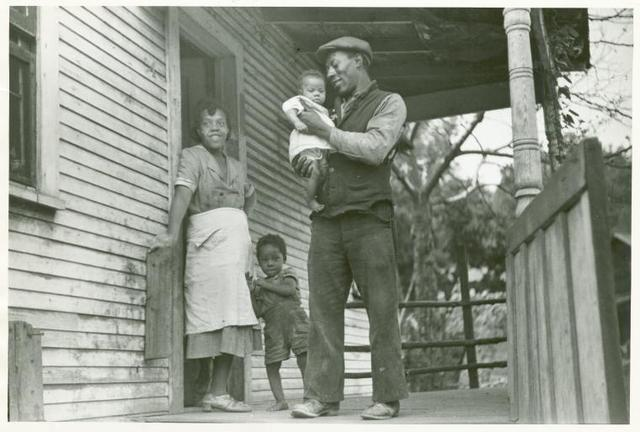 Coal miner, his wife and two children, [notice the child's legs], Bertha Hill, West Virginia, Sep. 1938.