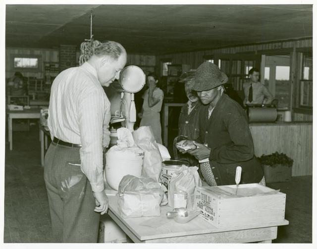 Southeast Missouri Farms--making a purchase at cooperative store, La Forge, Missouri, May 1938.