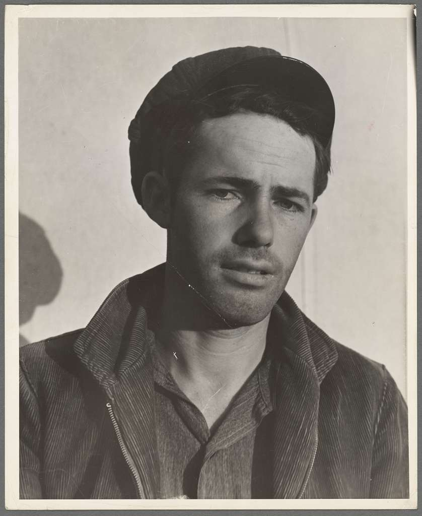 Son-in law of migratory family in Farm Security Administration (FSA) labor camp. Calipatria, Imperial Valley, California