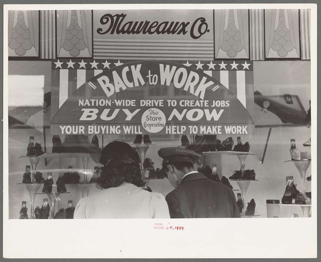 Window shoppers and sign on department store window, Mexican district, San Antonio, Texas