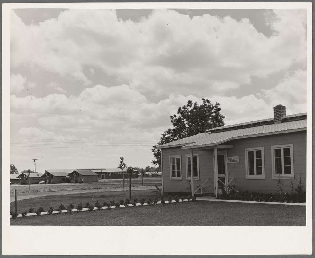Tulare County, California. Farm Security Administration (FSA) camp for migratory agricultural workers. View of camp, showing clinic in foreground