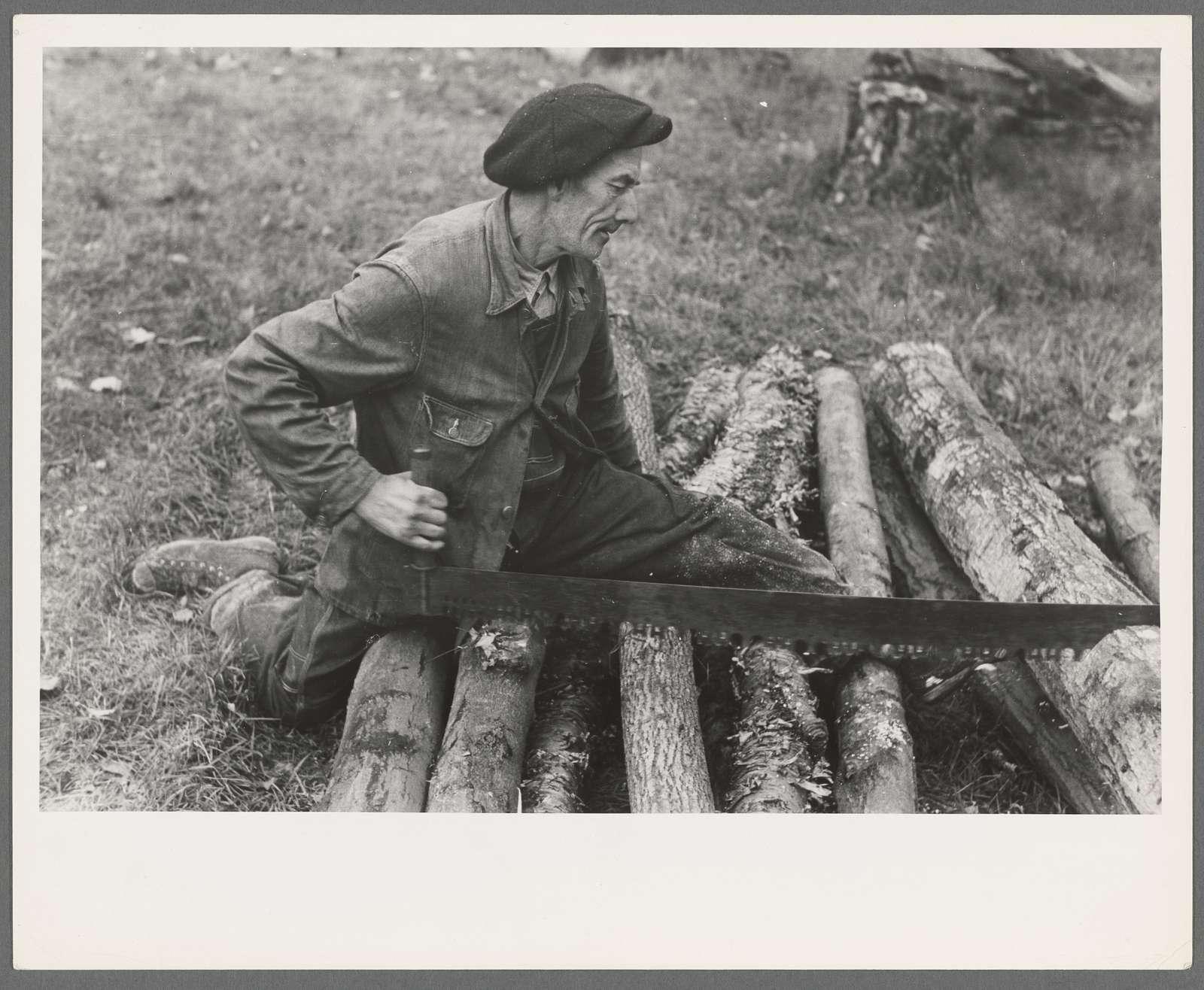 Farmer sawing wood near Bradford, Vermont
