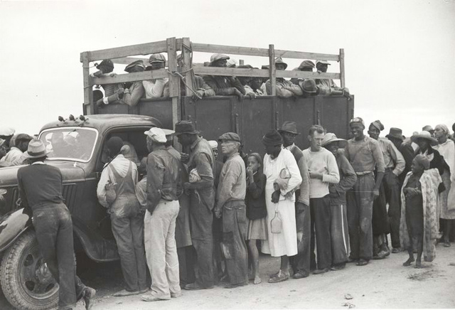 Vegetable pickers, migrants, waiting after work to be paid, near Homestead, Florida, February 1939.