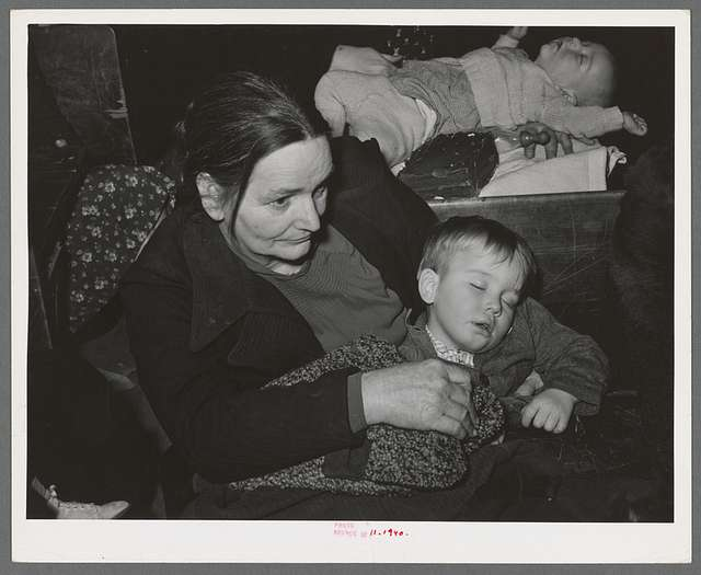 Farm woman and son at pie supper in Muskogee County, Oklahoma. See general caption number 24