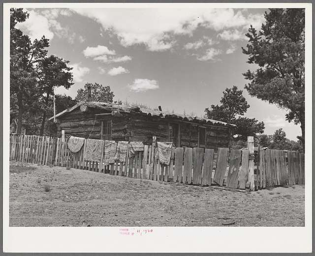 Log house of farmer with a fence of hand-split rails. Pie Town, New Mexico