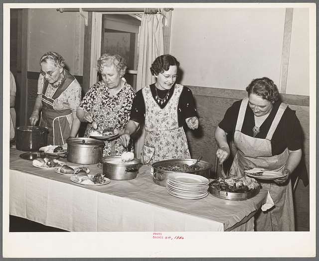 Dishing up dinner for the members of the Loomis Fruit Association cooperative who are holding their fortieth annual meeting. Loomis, California. Placer County