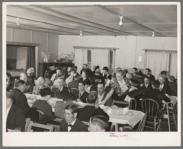 Members of the Loomis Fruit Association cooperative and their wives at dinner after fortieth annual meeting. Loomis, Placer County, California
