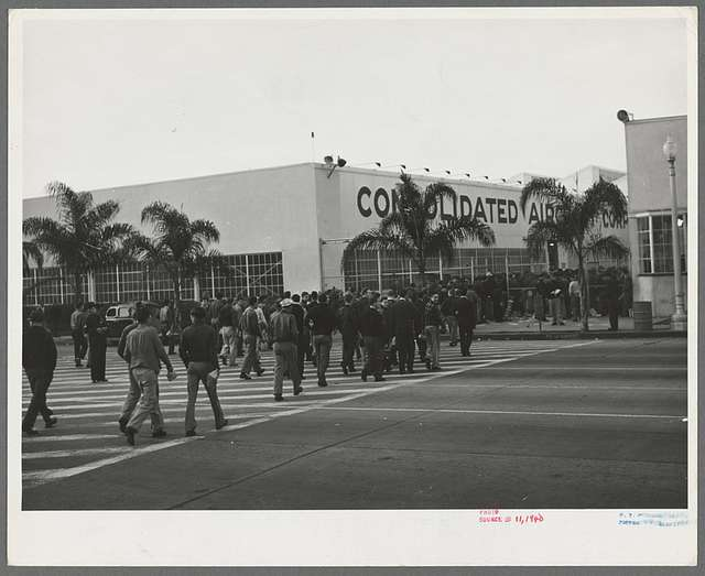 Workmen entering Consolidated Aircrafts early in the morning. San Diego, California