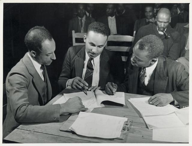 Working on the county maps at the colored County Land Use Planning Committee Meeting in the school house in Yanceyville, Caswell County, N.C. William L. Gilmore, teacher in Caswell County Training School, is Secretary of meeting. Oct 1940.