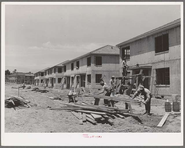Houses under construction at the Navy defense housing project for enlisted men in the Marines and Navy. San Diego, California