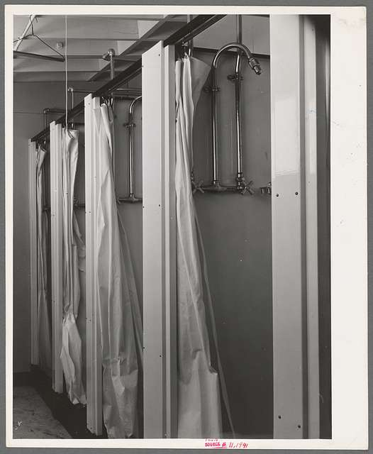 Showers at the FSA (Farm Security Administration) trailer camp for defense workers. San Diego, California