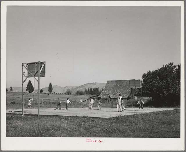 Basketball game. Children living at the FSA (Farm Security Administration) mobile camp for migratory farm workers. Odell, Oregon