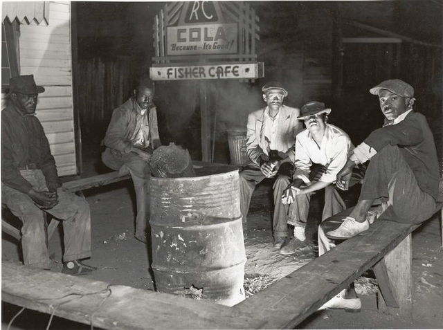 Negro laborers sitting around in front of a fire on Saturday night in a street of the Negro quarter of Belle Glade, Florida, February 1941.