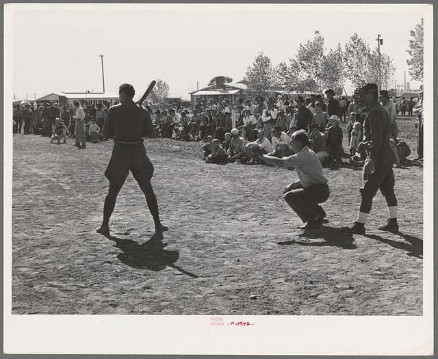 Boys from nearby Army camp play baseball at the field day at the FSA (Farm Security Administration) farm workers' community. Yuma, Arizona