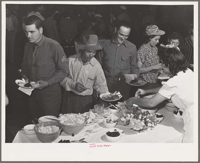 Farm workers at dinner at the second annual field day at the FSA (Farm Security Administration) farm workers' community. Yuma, Arizona