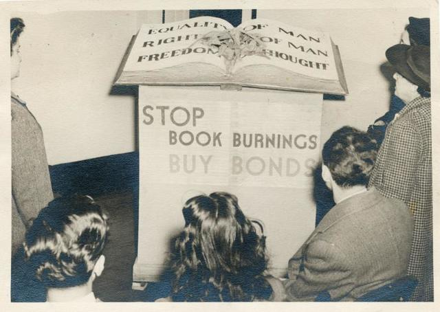 Book burning exhibit at the Muhlenberg branch library on West 23rd Street, Manhattan.  The New York Public Library Archives.