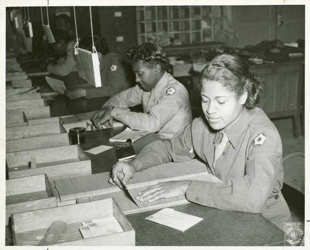 WACs expediting soldiers' mail at camp postoffice.