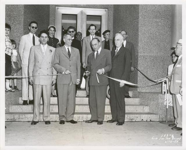 Dedication, Ribbon Cutting: (front row left-right) Raymond A. Harris, Librarian; Ralp A. Beals, Director, The New York Public Library; Honorable Frederick H. Zurmuhlen, Commissioner of Public Works; Mr. Morris Hadley, President, the New York Public Library. (rear row, at left) Peter B. Putnam, Author and Assistant Instructor, princeton University; (3rd from right) Mr. John M. Cory, Chief, Circulation Department, the New York Public Library