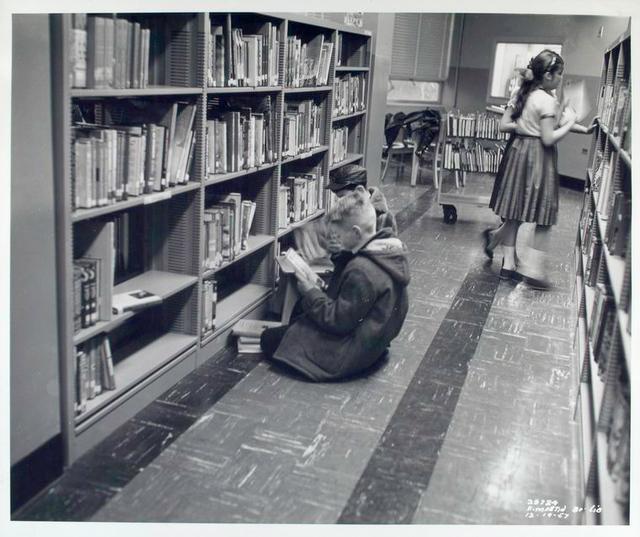 [Interior, children at bookshelves, Francis Martin Branch.]
