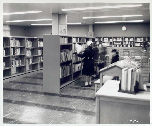 [Interior, patrons at bookshelves, Francis Martin Branch.]