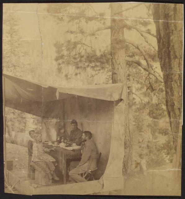 [An improvised dining room when we first reached Old Baldy (near San Bernadino, Calif.). RBS and family.]