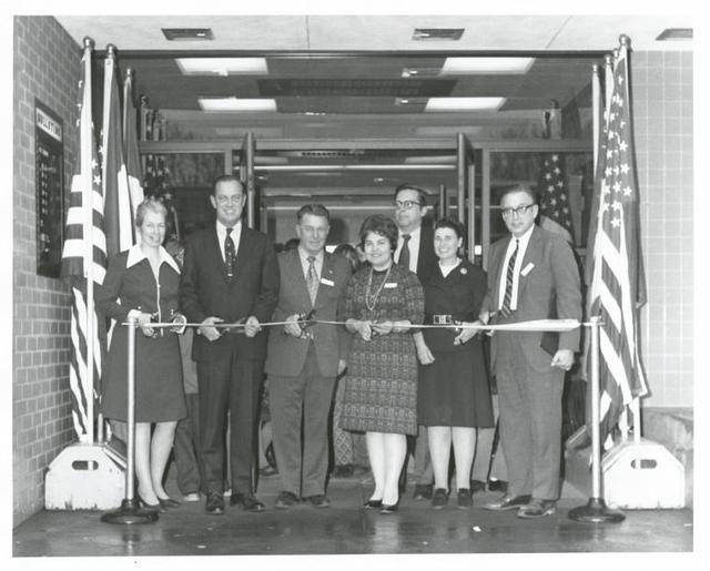 New Dorp, Dedication. From left: Joan treble, Richmond Borough Coordinator; Robert T. Connor, Richmond Borough President; Edward V. Curry, Councilman; Eleanor Ayoub, Branch Librarian; Holt Meyer, Director, Office of Staten Island Development; Julia Brody, Coordinator of Administrator Services; Alfred C. Maevis, Commissioner of Department of Public Works