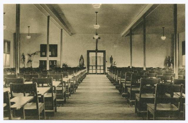 Assembly Hall, St. Joseph's-by-the-Sea, Huguenot Park, Staten Island, N.Y.  [int. with wooden desks and attached chairs]