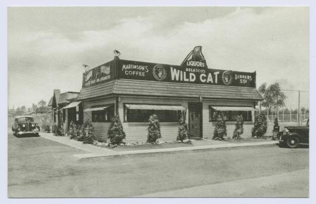 Belasco's Wild Cat (ext. with signs on building, lager beer on draught, Martinson's coffee, liquors, dinners 55 cents, 40's cars in parking lot