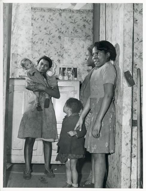 Children of defense worker; Negro slum district, Norfolk,Va., Mar. 1940.