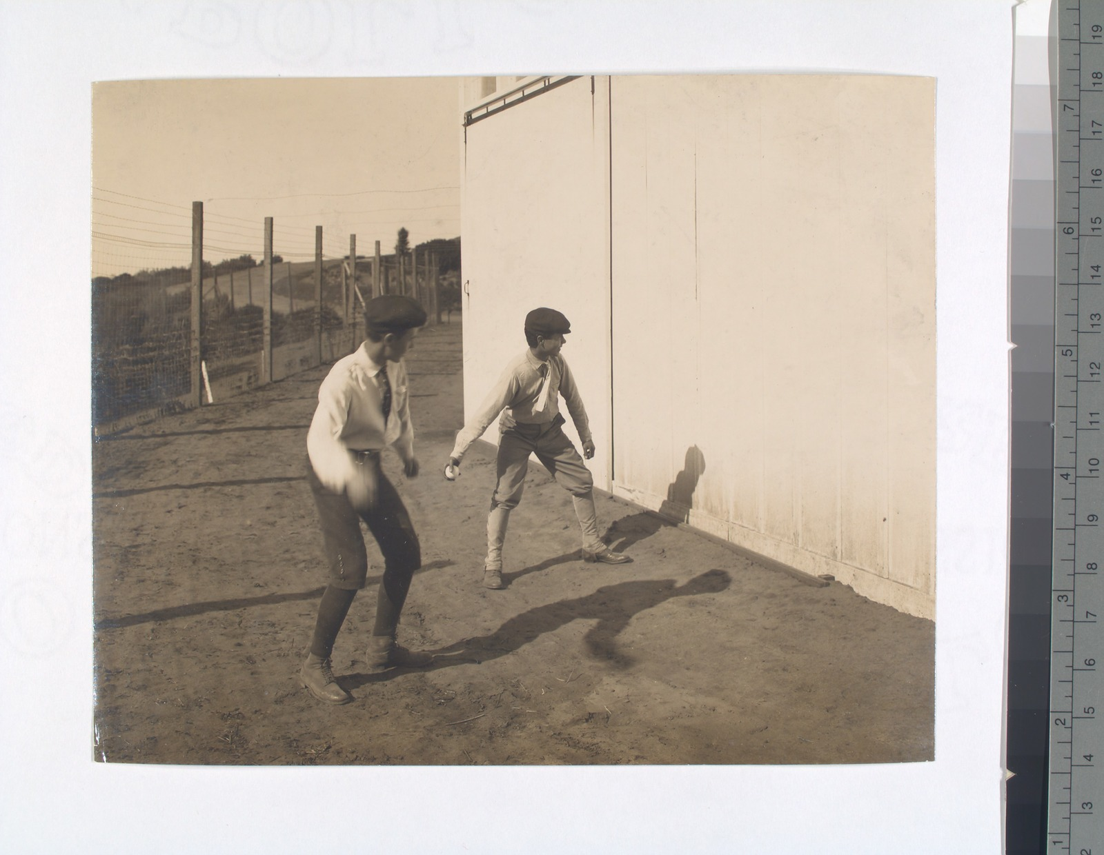 Fig. 2: Two boys with a ball, playing Hand Ball