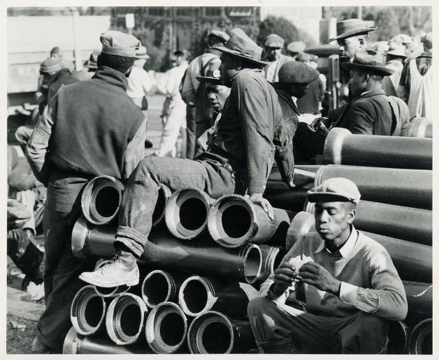 Lunch time on emergency defense office housing construction job; Washington, D. C.; December, 1941.