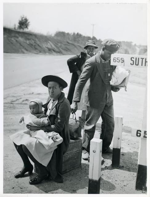 Negro family waiting for ride into town, Halifax County, Va. Mar. 1941.