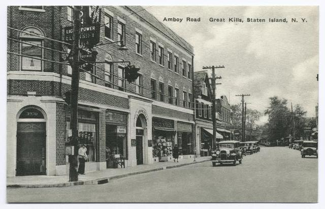 Amboy Road, Great Kills, Staten Island, N.Y.  [old cars in street, shops and sign behind telephone pole that appears to be 'Light, Power...  Gas...Electric']