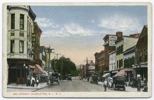 Bay Street, Stapleton, Staten Island, N.Y. [old cars in street, horse and wagon, people walking, red-striped awnings on shops, sign for hotel, sign on building  E.D. Wayman Dry Goods and Millinery]