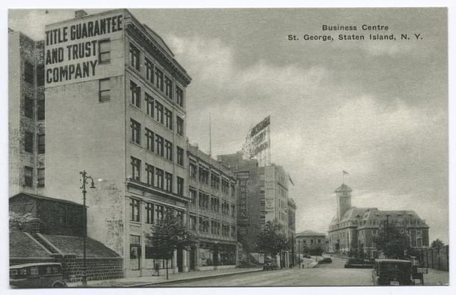 Business Centre, St. George, Staten Island, N.Y.[old car in street and 'Title Guarantee and Trust Company' painted on side of 6-story building]